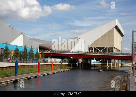 Aquatics Centre and River Lea on a sunny day at Olympic Park, London 2012 Olympic Games site, Stratford London E20 - Stock Image