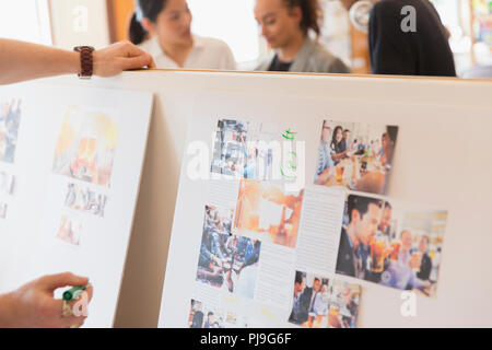 Creative designers reviewing story board proofs - Stock Image