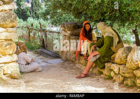 A young man and woman in period costume in the open air museum of Nazareth Village Israel. This site provides an authentic look at life in Israel - Stock Image