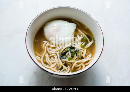 Homemade Japanese Ramen Noodle with Poached Eggs. Traditional Organic Food. - Stock Image