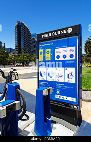 The RACV operated Melbourne Bike Share hire in Melbourne Docklands, is a great way to see the surrounding Docklands sights. - Stock Image