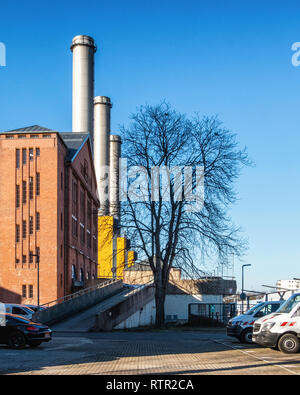 Berlin-Wilmersdorf. Vattenfall Co-generation power station produces heat & electricity.It was built in 1977 and has three 102m Chimneys - Stock Image