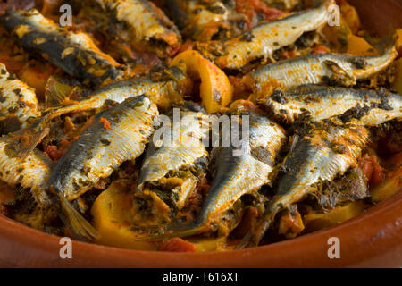 Traditional  Moroccan Tagine with stuffed sardines and vegetables close up - Stock Image