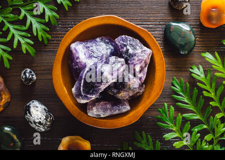 Crystals of Aries including, Amethyst, Bloodstone, Apache Tears and Fire Agate - Stock Image