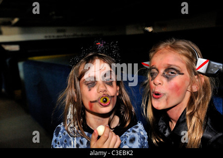 two children (9 years old) in horror zombie Halloween makeup - Stock Image