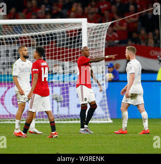 Optus Stadium, Burswood, Perth, W Australia. 17th July 2019. Manchester United versus Leeds United; pre-season tour; Ashley Young of Manchester United makes a point to Adam Foresaw of Leeds United Credit: Action Plus Sports Images/Alamy Live News - Stock Image