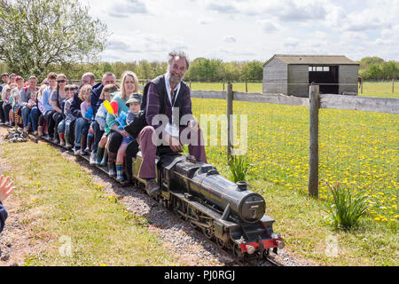 Miniature Steam Railway with families of parents and young children - Stock Image