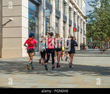 Group,of,Girl,Joggers,King;s Boulevard,Kings Cross,London,England - Stock Image