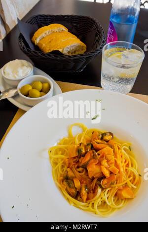 Seafood spaghetti, New Cocoa restaurant, Port d'Alcudia, Mallorca, Balearic islands, Spain - Stock Image