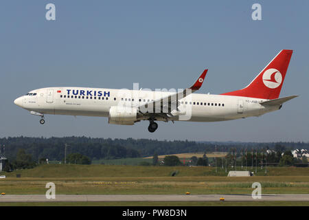 Turkish Airlines Boeing 737-800 (old livery) with registration TC-JGD on short final for runway 14 of Zurich Airport. - Stock Image