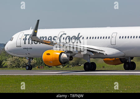 Thomas Cook Airlines Airbus A321-200, registration G-TCDJ, taking off at Manchester Airport, England. Detail shows engine on wing. - Stock Image