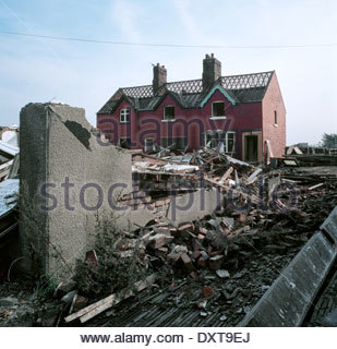 House being demolished in the former mining village of Arkwright Town, Derbyshire, UK. - Stock Image
