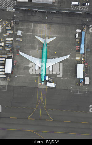 Boeing 737-800 outside the production-line factory parked before being painted and making a test-flight - Stock Image