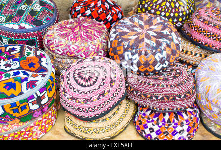 Colorful traditional men's hats on sale at a Turkish market - Stock Image