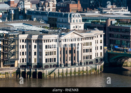 Elevated view of the river frontage of Vintner's Hall & Vintry Place on the north side of Southwark Bridge. - Stock Image