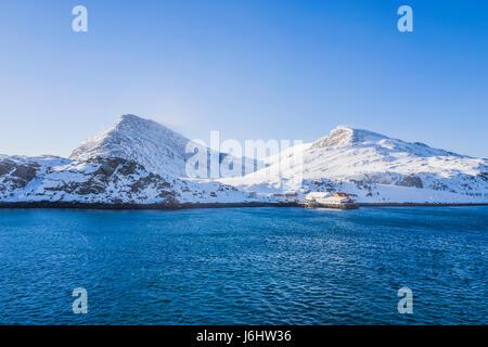 Spectacular mountain scenery seen from a Hurtigruten Coastal Express cruise ship, at Havøysund, Norway. - Stock Image