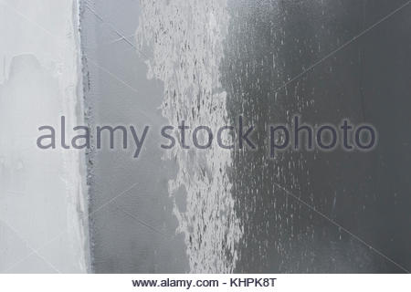 Grey silver textured concrete background wet rain - Stock Image