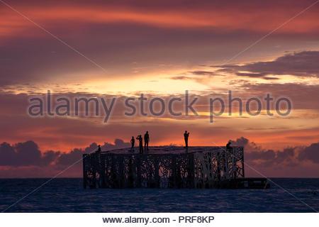 Coralarium sculpture installation at sunset in Maldives - Stock Image