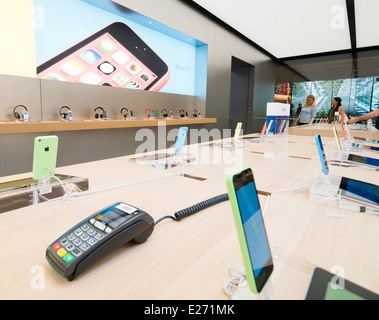 The Apple iPhone 5C on display in The Apple store - Stock Image