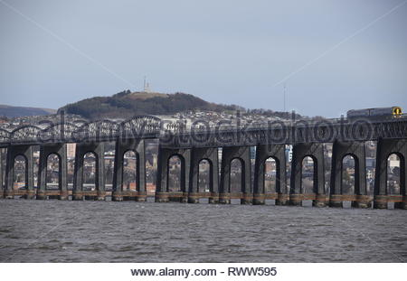 Train crossing Tay Rail Bridge Scotland  March  2019 - Stock Image
