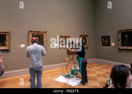 Visitor painting the Self-Portrait by Rembrandt , The Metropolitan Museum of Art, Manhattan, New York USA - Stock Image
