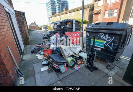 Flytipping by communal waste bins in Brighton Sussex UK - Stock Image