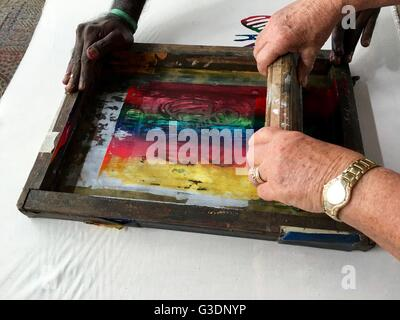 Silk screening a dragonfly image on a tea towel on Bathurst Island, one of the two Tiwi Islands. - Stock Image