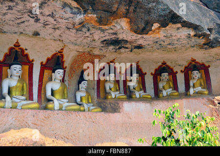 Po Win Daung mountain caves richly decorated caves. carved into a sandstone outcrop containing numerous carved Buddha - Stock Image