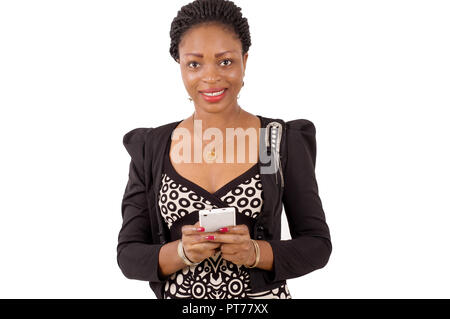 Portrait of smiling young woman handling a mobile phone. - Stock Image