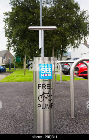 Fixed bicycle tyre air pump sited on Coniston Village car park adjacent to the tourist information office, Coniston in the English Lake District. - Stock Image