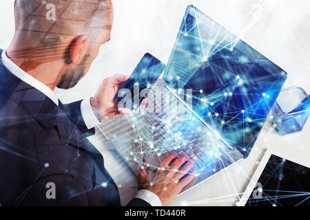 Businessman works with laptop. Concept of teamwork and partnership. double exposure with network effects - Stock Image