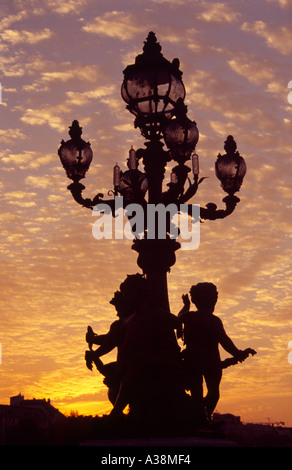 Silhouette of a Lamp at Sunset on a Paris Bridge - Stock Image