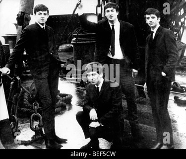 The Beatles on the deck of a ship in the mid-1960's (L-R) PAUL MCCARTNEY, GEORGE HARRISON, JOHN LENNON, and - Stock Image