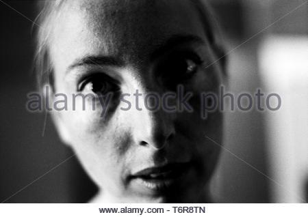Tilburg, Netherlands. Black & White portrait of a young, caucasian woman. Image shot on analog B&W Kodak T-max film. - Stock Image