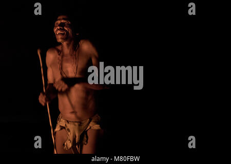 A San bushman tells a story around a fire in Ghanzi, Botswana. - Stock Image