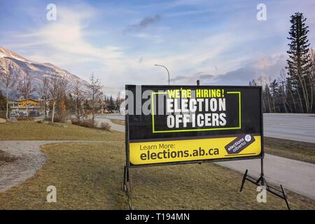 Roadside Hiring Sign next to Elevation Place Recreation Centre in Town of Canmore for upcoming Alberta Provincial Elections in month of April 2019 - Stock Image