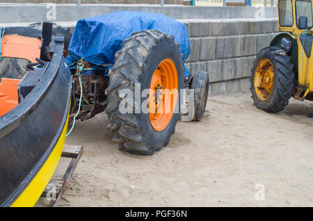 Old Rusty Tractors Filey Sea front North Yorkshire UK - Stock Image