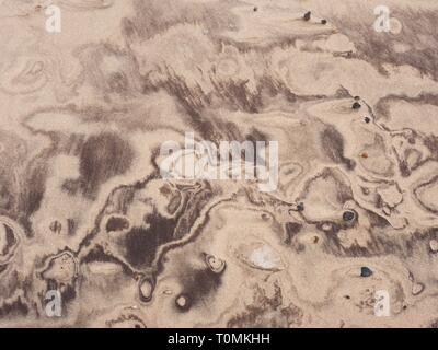 Desert sand pattern with  beautiful shapes from crushed shells and another sediments, natural background - Stock Image