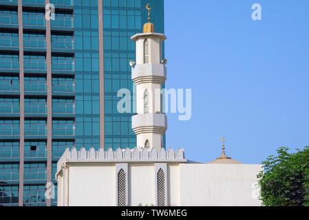 Modern high rise and mosque, Abu Dhabi, United Arab Emirates - Stock Image