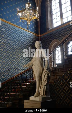 The Adam Smith statue / sculpture in the period staircase of the Gilbert Scott building in Glasgow University, Scotland, UK - Stock Image