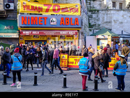 Istanbul, Turkey..  Thousands wait in line to buy ticket for the Turkish national lottery's New Year's eve draw some waiting over 3 hours from the Nimet Abla in Eminonu Square, an annual tradition due to believed lucky nature of the establishment. - Stock Image