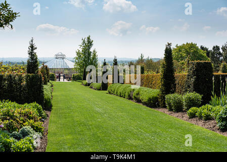 The rose garden at RHS Hyde Hall, looking towards the global growth vegetable garden - Stock Image