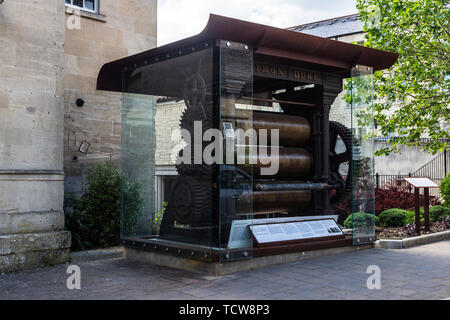 The Iron Duke the first rubber rolling or calendaring machine in Europe on display in the town of Bradford on Avon where it was first used. - Stock Image