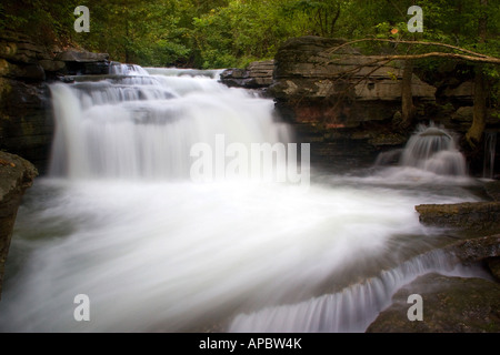 Water flows over a waterfall below the Lake Ann dam in Bella Vista, Ark. - Stock Image