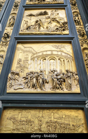 Florence, Italy. The Baptistery. Detail of East Doors (the 'Gates of Paradise', 1425-1452) by Ghiberti, showing Joseph (centre) and Abraham (above) - Stock Image