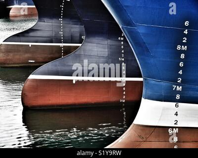 Low tide showing bows of fishing vessels whilst moored in harbour, Fraserburgh, Scotland, UK - Stock Image