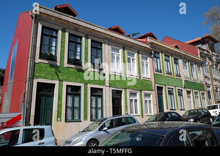 Exterior view of apartment buildings with green tiless facade on sloping street hillside in the city of Porto, Oporto, Portugal Europe   KATHY DEWITT - Stock Image