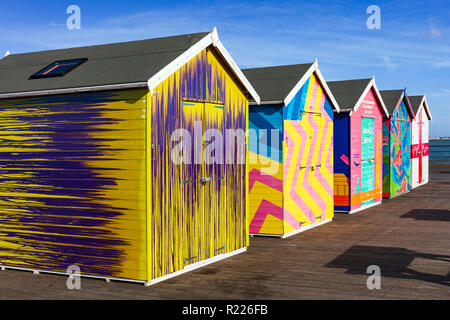 Colourful painted sheds on Southend Pier. - Stock Image