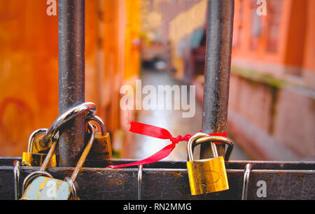 love padlocks in Bologna canal bridge - Italy - Stock Image