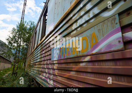 Detail of sleeping car train covered by graffiti at the abandoned Canfranc International railway station (Canfranc, Pyrenees, Huesca, Aragon, Spain) - Stock Image
